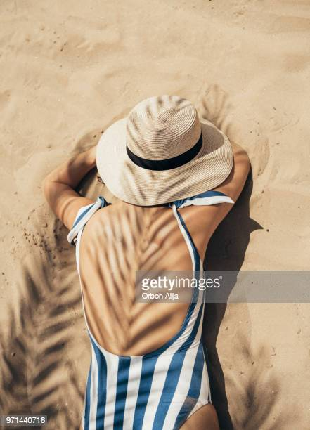 young woman at italian beach - women sunbathing stock photos and pictures