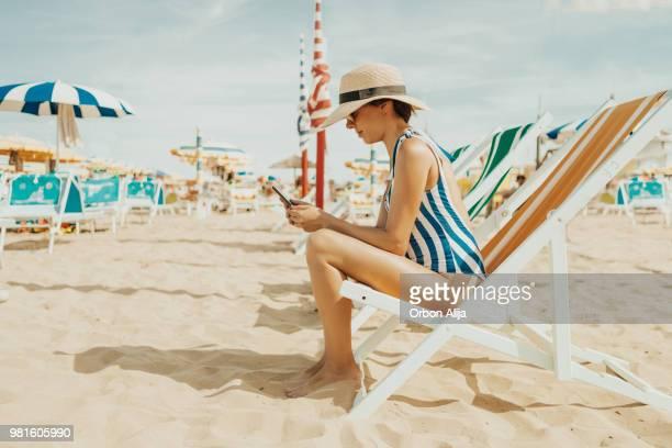 Young woman at italian beach