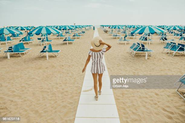 young woman at italian beach - emilia romagna stock photos and pictures
