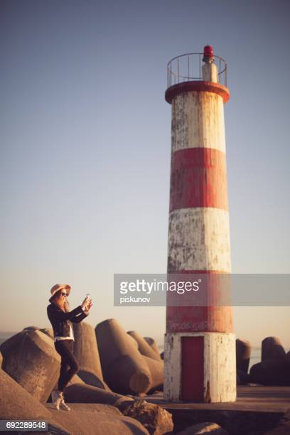 Young woman at lighthouse
