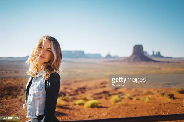 young woman at monument valley - arizona stock pictures, royalty-free photos & images