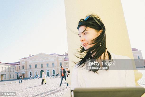 Young Woman At Peter and Paul Fortress Using Digital Tablet