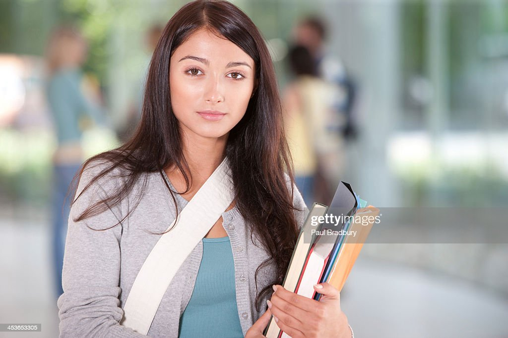 Young Woman at school with school books : Stock Photo