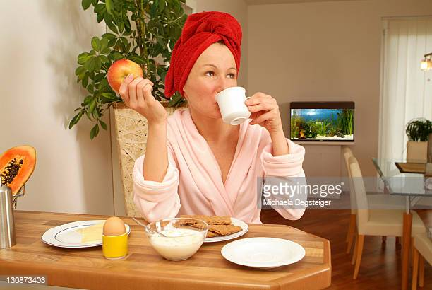 young woman at substantial breakfast - fat women in bath stock pictures, royalty-free photos & images