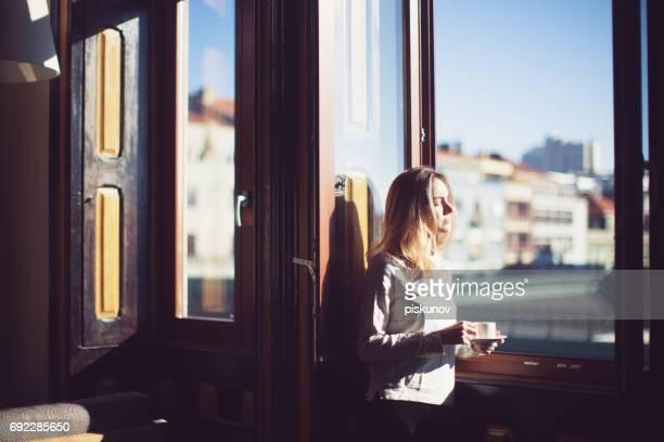Young woman at sunny morning