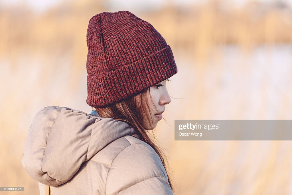 Young woman at sunset : Stock Photo
