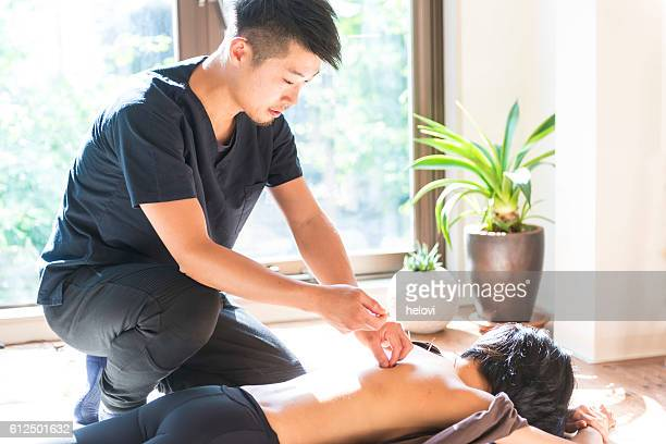 Young woman at the acupuncture treatment