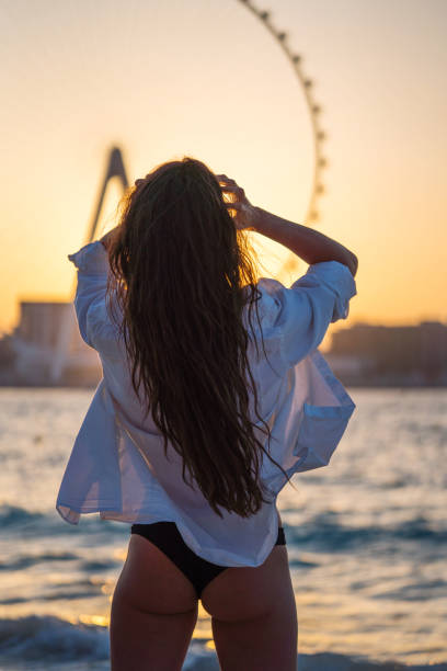 Young Woman At The Beach At Sunset