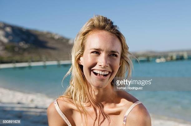 young woman at the beach - blond frauen strand stock-fotos und bilder