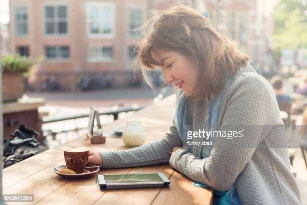 Young woman at the cafe