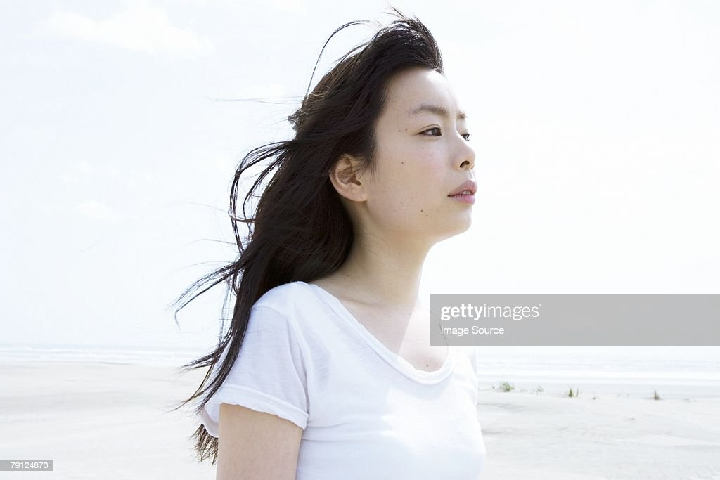 Young woman at the coast : Stock Photo