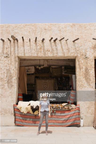 young woman at the doha souq waqif - doha stock pictures, royalty-free photos & images