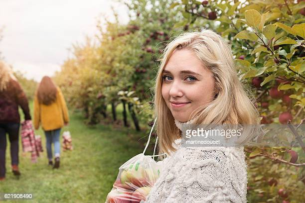 Young woman at the end of day in orchard, autumn.