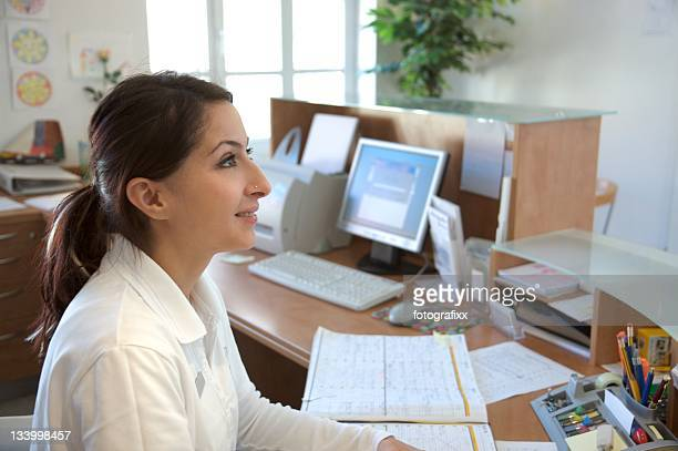 young woman at the reception desk
