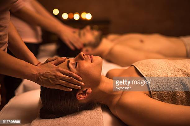 young woman at the spa enjoying in head massage. - massage stock pictures, royalty-free photos & images
