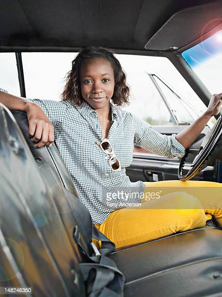 Young woman at the wheel of a car