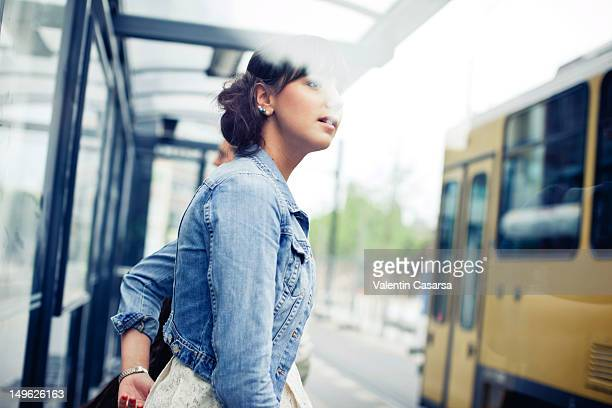 Young woman at tram station