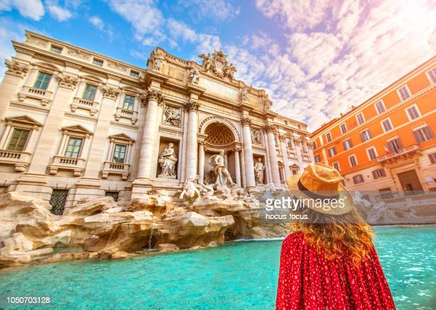 young woman at trevi fountain rome - trevi fountain stock photos and pictures