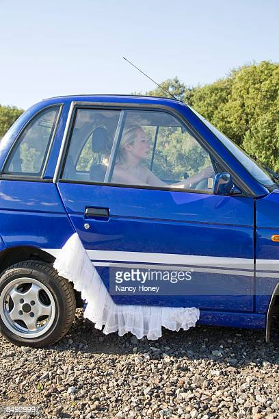 young woman at wheel of electric car - up skirts stock pictures, royalty-free photos & images