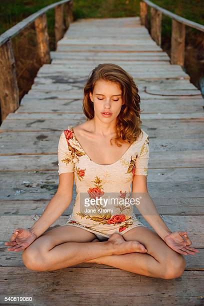 young woman athlete doing yoga exercise - legs apart stock photos and pictures