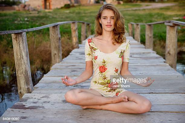 Young woman athlete doing yoga exercise