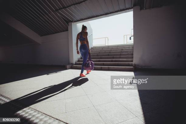 Young woman athlete on stadium entrance