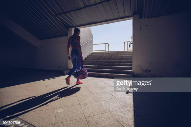 young woman athlete on stadium entrance - gym bag stock pictures, royalty-free photos & images