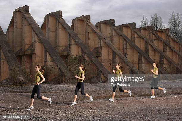 Young woman athlete running by old ruins, multiple exposure