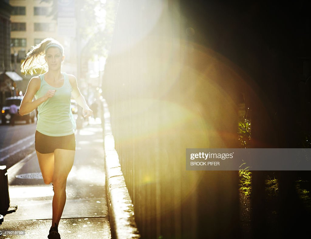 Young woman athlete running : Stock Photo