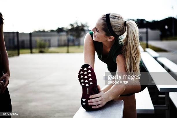 Young woman athlete stretching