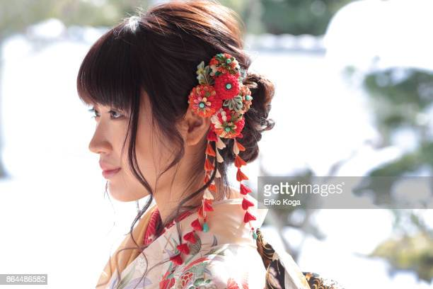 young woman attached hair ornament for coming‐of‐age ceremony - seijin no hi stock pictures, royalty-free photos & images