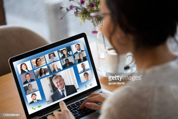 young woman attending video conference on laptop computer - employee engagement stock pictures, royalty-free photos & images