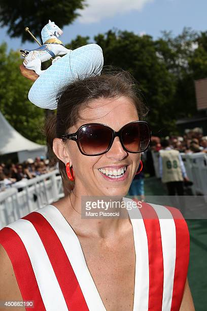 A young woman attends the 'Prix de Diane Longines 2014' at Hippodrome de Chantilly on June 15 2014 in Chantilly France