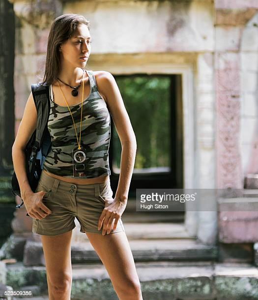 young woman backpacker in old temple - hugh sitton bildbanksfoton och bilder