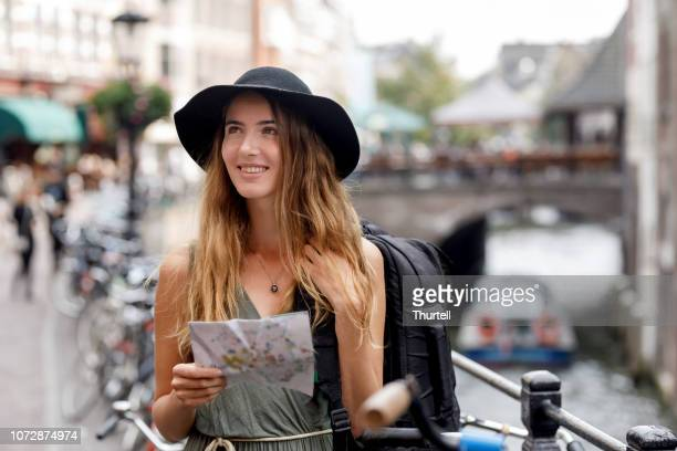 young woman backpacking in europe - utrecht stock pictures, royalty-free photos & images