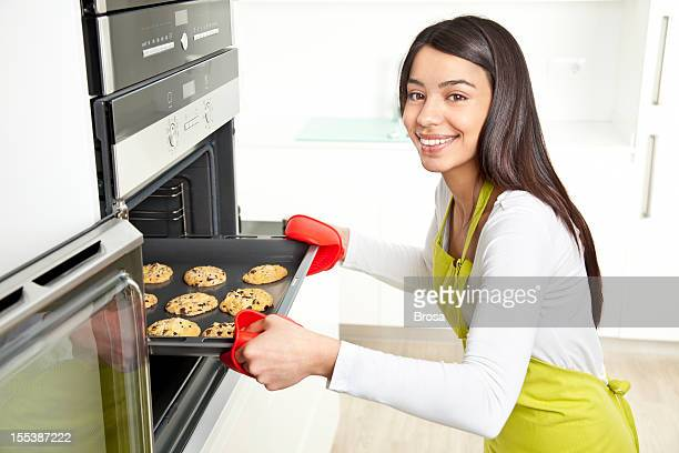 Young woman baking cookies at home