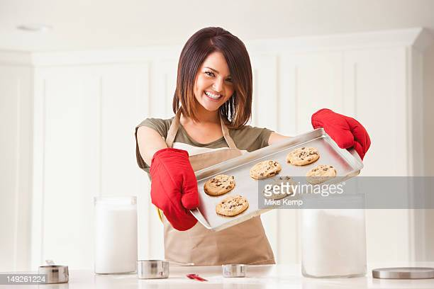 Young woman baking cookies