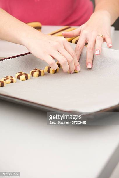 Young woman baking in kitchen