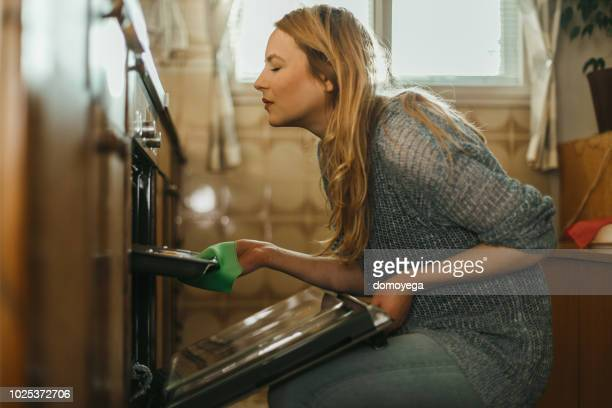 young woman baking pastries in the kitchen at home - baked stock pictures, royalty-free photos & images