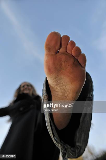 young woman (22)  balancing, barefooted - female feet soles stock photos and pictures