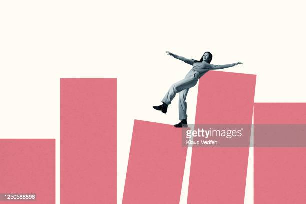 young woman balancing on large coral columns - struggle stock pictures, royalty-free photos & images