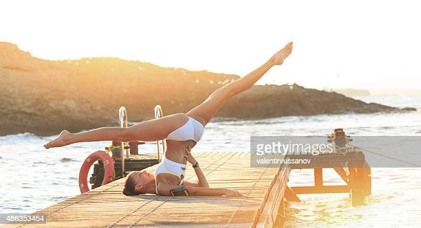 young woman ballet dancer demonstrating yoga flexibility - soul train dancers stock photos and pictures