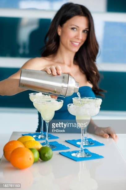 Young Woman Bartender Pouring Margaritas