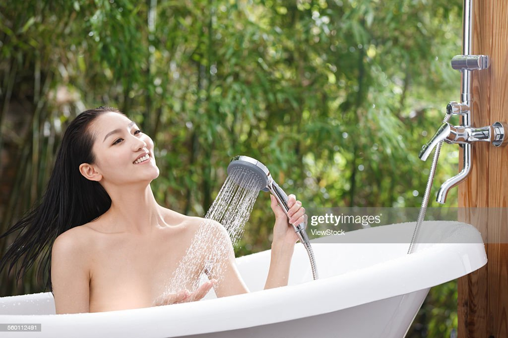 A Young Woman Bathing In A Bathtub Stock Photo | Getty Images