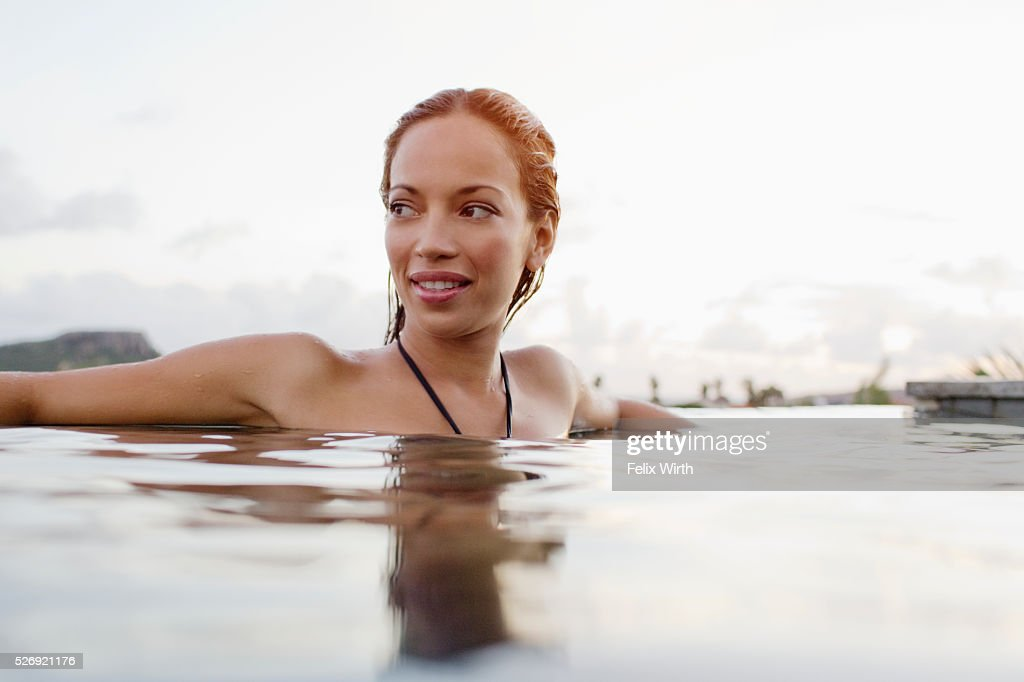 Young woman bathing in swimming pool : Photo