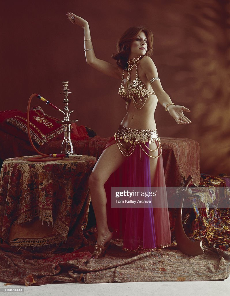 Young woman belly dancing : Stock Photo