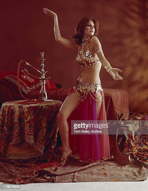 young woman belly dancing - belly dancing stock photos and pictures