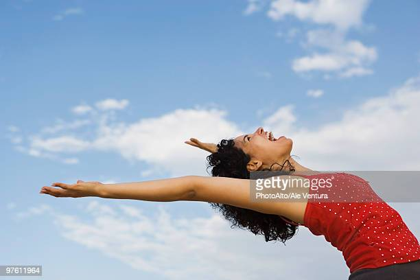 young woman bending over backwards, laughing - bending over backwards stock photos and pictures