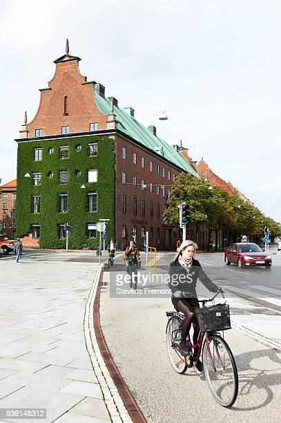 Young woman bicycling in the streets of Malmo
