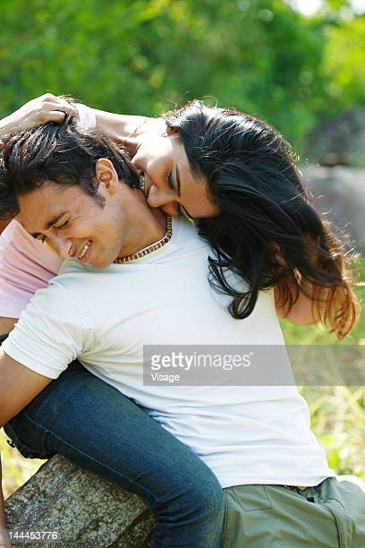 Young woman biting her boyfriend's neck